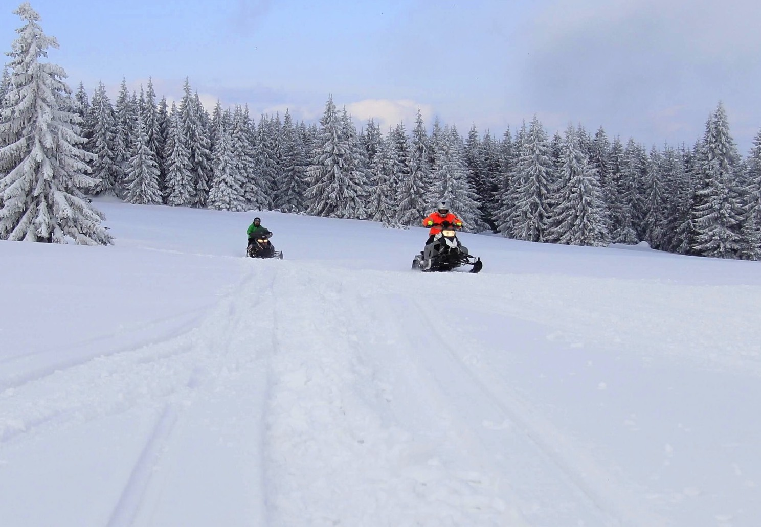 SNOW MOBILE ADVENTURE NEAR TATRA MOUNTAIN IN SLOVAKIA DUPLIK